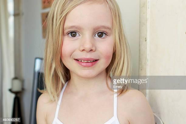 Portrait of innocent young girl in corridor