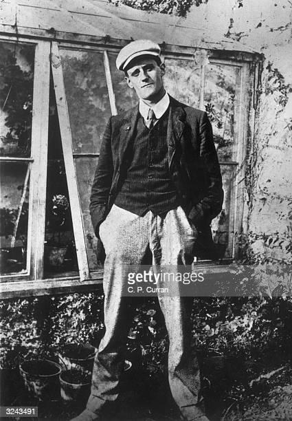 Portrait of Irish writer James Joyce aged 22 standing outdoors