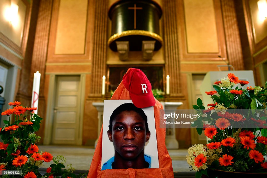 A portrait of Islamic State (IS) fighter Florent Prince N., a 17-year-old also called Bilal, stands on display at the St. Pauli Church prior to an interfaith memorial service for him on May 27, 2016 in Hamburg, Germany. Florent was born in Cameroon and grew up as a Christian in Hamburg, where he eventually converted to Islam and became radicalized. In May of 2015 he traveled to Syria, joined the Islamic State and was killed that summer. While still a Christian Florent was active in the St. Pauli Church community.