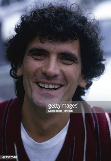 Portrait of Italian actor and director Massimo Troisi smiling 1987