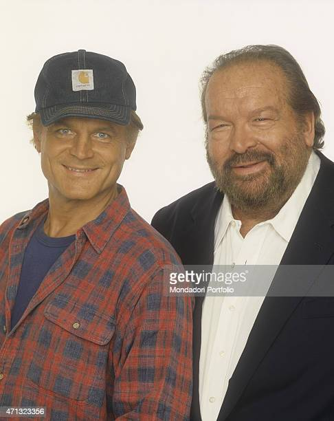 Portrait of Italian actor and director Terence Hill with a Carhartt cap smiling beside Italian actor and swimmer Bud Spencer 1994