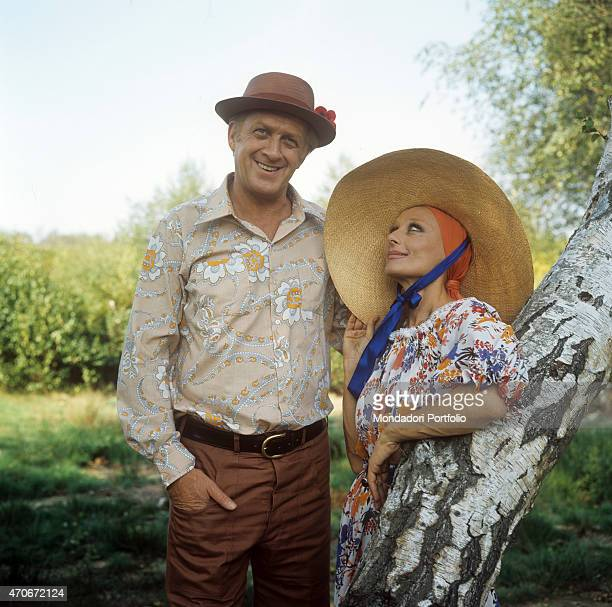 'Portrait of Italian actor and TV host Raimondo Vianello and his wife and Italian actress Sandra Mondaini wearing big straw hats They present...