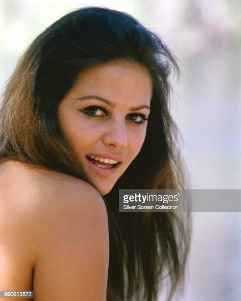 Portrait of Italian actress Claudia Cardinale as she glances back over her bare shoulder mid to late 1960s