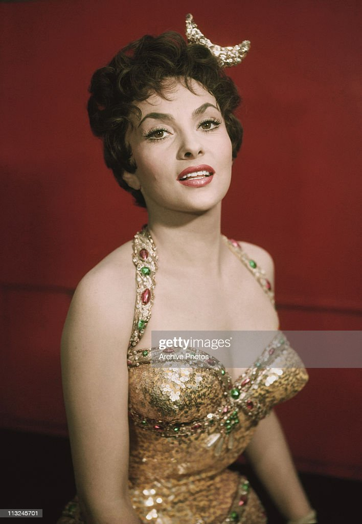 Portrait of Italian actress Gina Lollobrigida in a jewelled gold dress circa 1960.