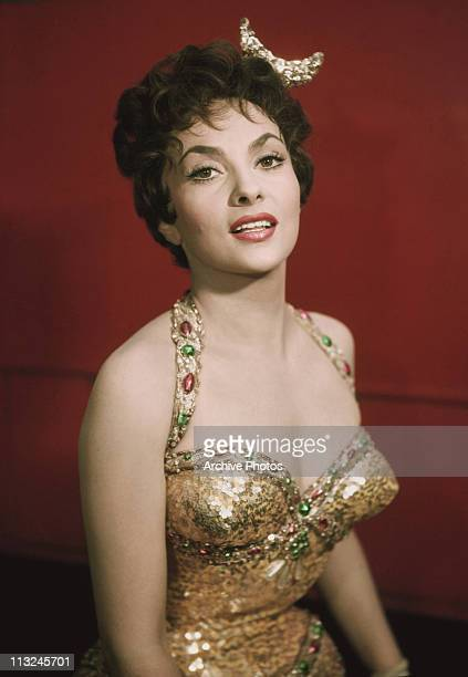 Portrait of Italian actress Gina Lollobrigida in a jewelled gold dress circa 1960