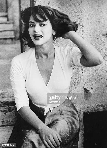 Portrait of Italian actress Giovanna Ralli sitting on a stone step she is soon to star in the film 'Si' at Cinecitta in Rome May 19th 1955