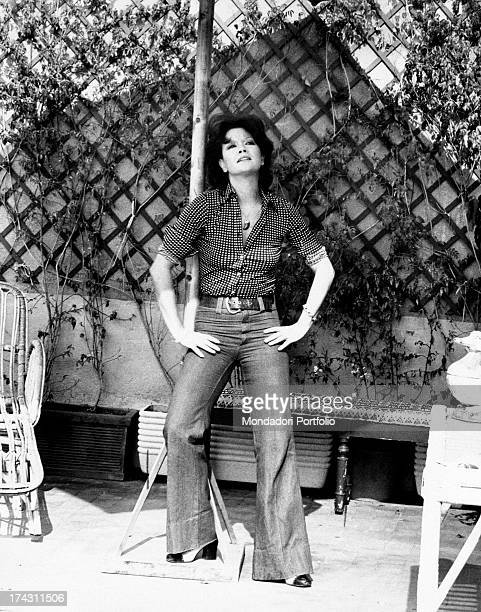 Portrait of Italian actress Valeria Moriconi with her hands on her hips Rome 1974