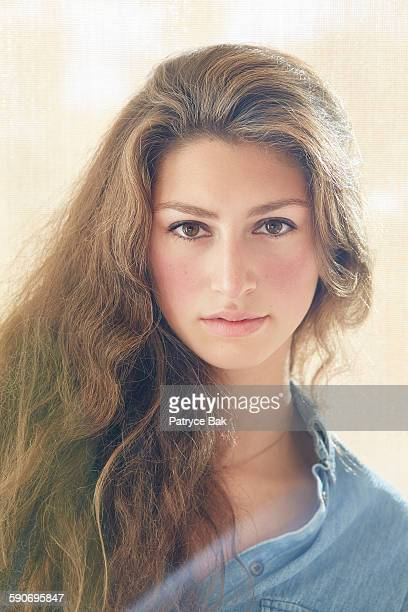 Portrait of Italian looking young woman with flare