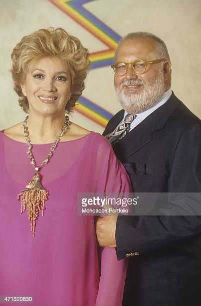 Portrait of Italian singer and TV presenter Iva Zanicchi smiling beside Italian fashion designer Gianfranco Ferr at his atelier on via Pontaccio...