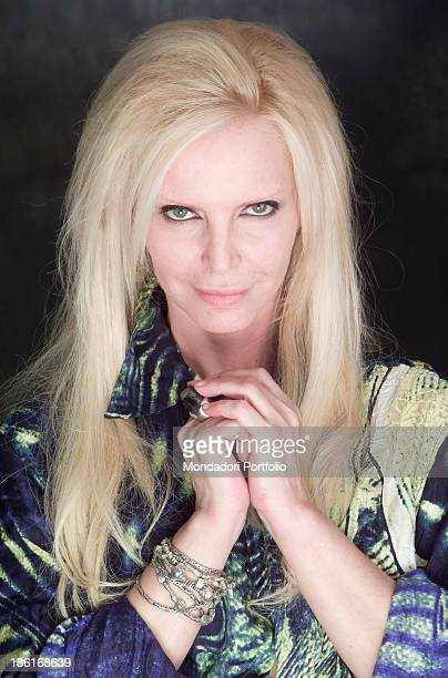 Portrait of Italian singer Patty Pravo joining her hands She's wearing a patterned shirt by Roberto Cavalli 27th March 2002