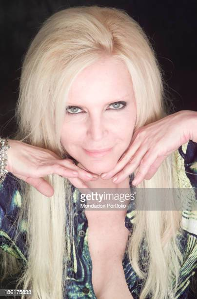 Portrait of Italian singer Patty Pravo smiling She's wearing a lownecked shirt by Roberto Cavalli 27th March 2002