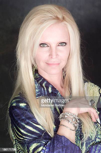 Portrait of Italian singer Patty Pravo smiling wearing a patterned shirt by Roberto Cavalli 27th March 2002