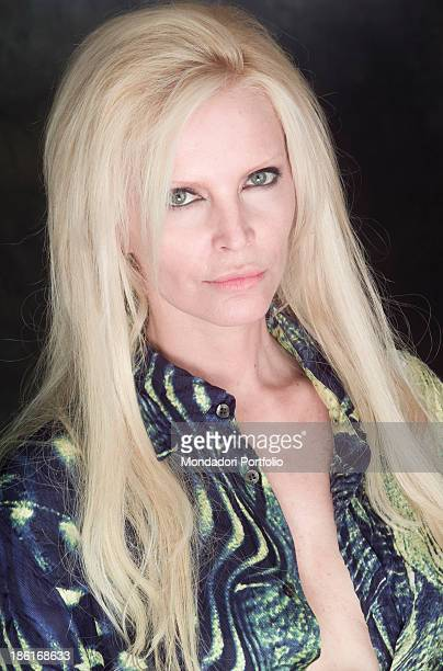 Portrait of Italian singer Patty Pravo wearing a patterned shirt by Roberto Cavalli 27th March 2002