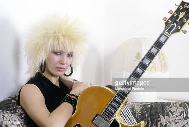 Portrait of Italian singersongwriter Ivana Spagna with a guitar 1986