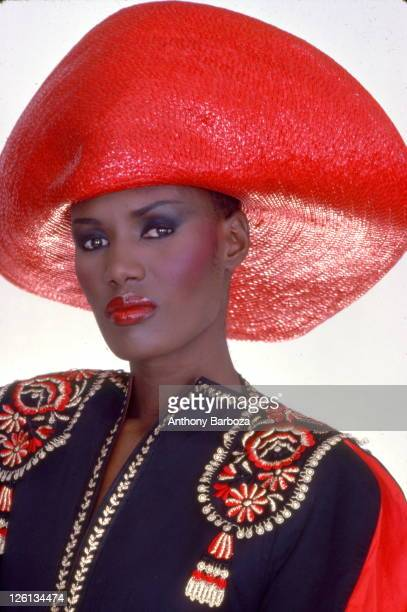 Portrait of Jamaicanborn model singer and actress Grace Jones wearing a bright red hat and multicolored top New York late twentieth century