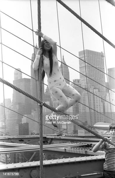 Portrait of Japanese artist Yayoi Kusama as she poses on the Brooklyn Bridge dressed in polka dots New York New York May 17 1968