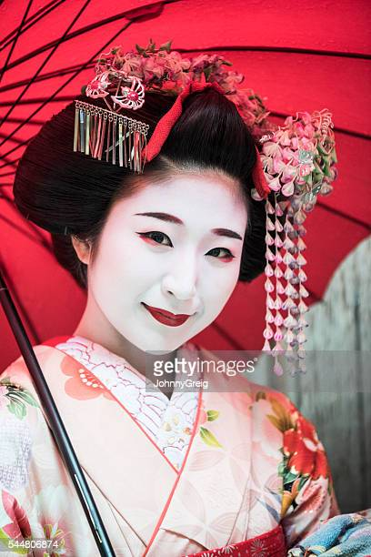 Portrait of Japanese Maiko in traditional make up and kimono
