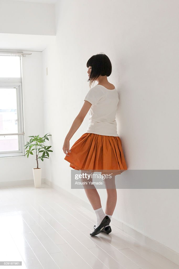 Portrait of Japanese woman in room