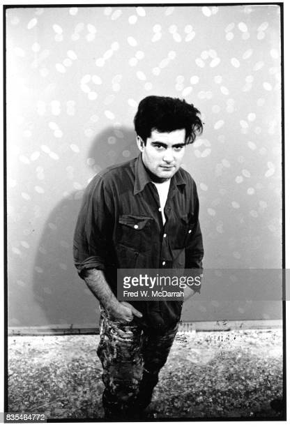 Portrait of Japaneseborn American artist Lawrence 'Larry' Poons as he posing in front of one of his painting in his Greenwich Village loft New York...