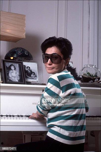 Portrait of Japaneseborn artist and musician Yoko Ono as she sits at a piano in her home at the Dakota Apartments New York New York November 13 1982