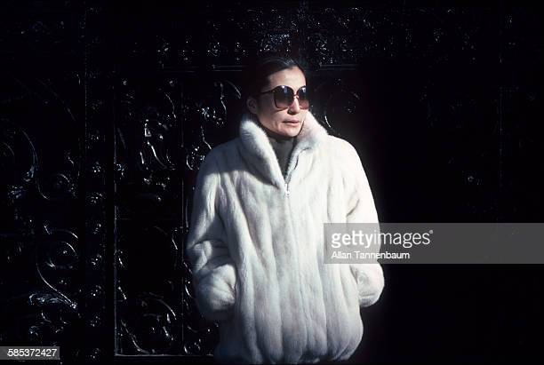 Portrait of Japaneseborn artist and musician Yoko Ono as she stands at the gates to the Dakota Apartments where she lives New York New York January...