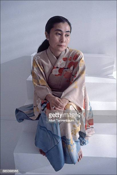 Portrait of Japaneseborn artist and musician Yoko Ono dressed in a kimono as she sits on a step in a SoHo gallery New York New York November 26 1980...