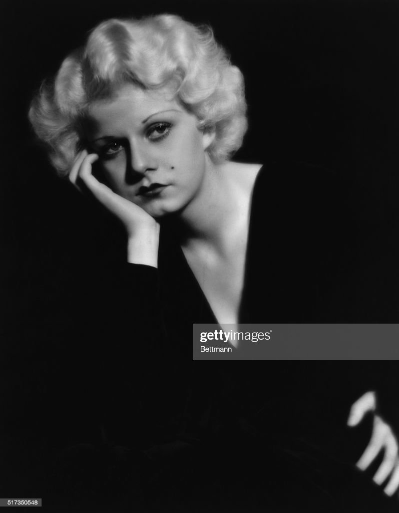 Portrait of <a gi-track='captionPersonalityLinkClicked' href=/galleries/search?phrase=Jean+Harlow&family=editorial&specificpeople=70012 ng-click='$event.stopPropagation()'>Jean Harlow</a> in a pensive pose, wearing a black v-necked dress. Undated photograph.