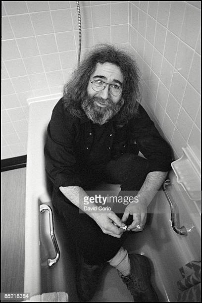 Portrait of Jerry Garcia of the Grateful Dead in his clothes in the bath London 22nd March 1981