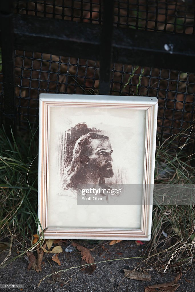 A portrait of Jesus sits on the edge of the sidewalk outside the Uptown Baptist Church near where the victims of Monday's shooting fell on August 21, 2013 in Chicago, Illinois. Five people were shot while standing in front of the church on August 19 when a gunman opened fire from a passing car.