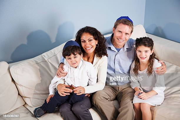 Portrait of Jewish family sitting on sofa