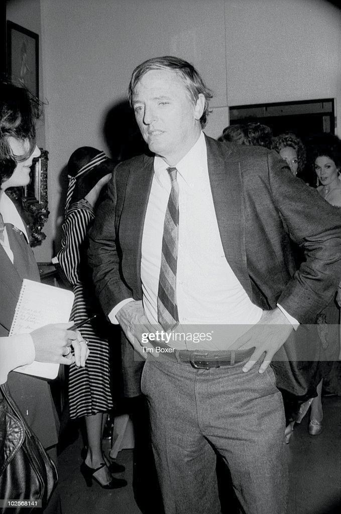 Portrait of journalist, author, and founder of the National Review William F. Buckley Jr (1925 - 2008) as he stands with his hands on his hips at a party in honor of the CBS television series 'Beacon Hill,' New York, New York, July 29, 1975.