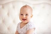 childhood, babyhood and people concept - portrait of joyful baby boy.