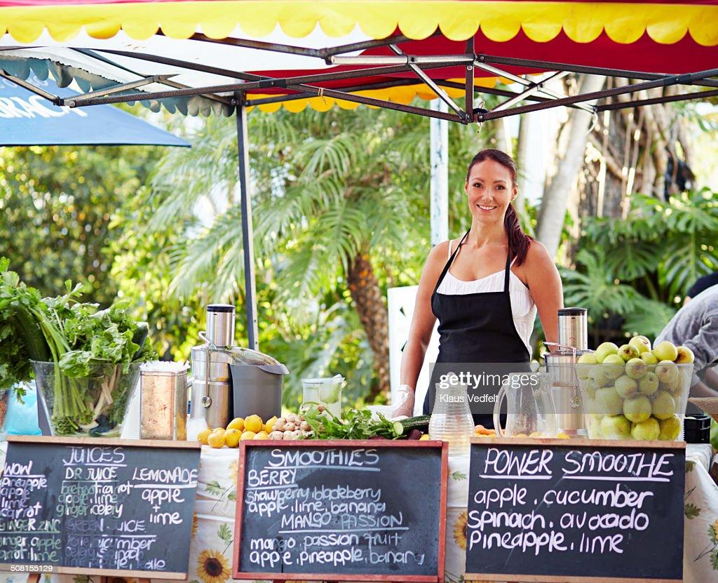 Portrait of juice shop owner at outside foodmarket