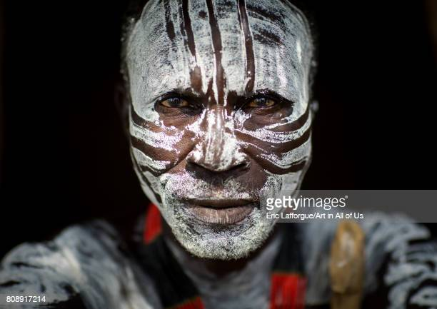 Portrait of Karo tribe man white painted face Omo valley Korcho Ethiopia on June 11 2017 in Korcho Ethiopia