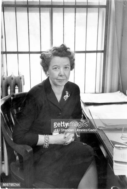Portrait of Katharine Hafstad historian and researcher at the Operations Research Office Johns Hopkins University seated in office wearing dress and...