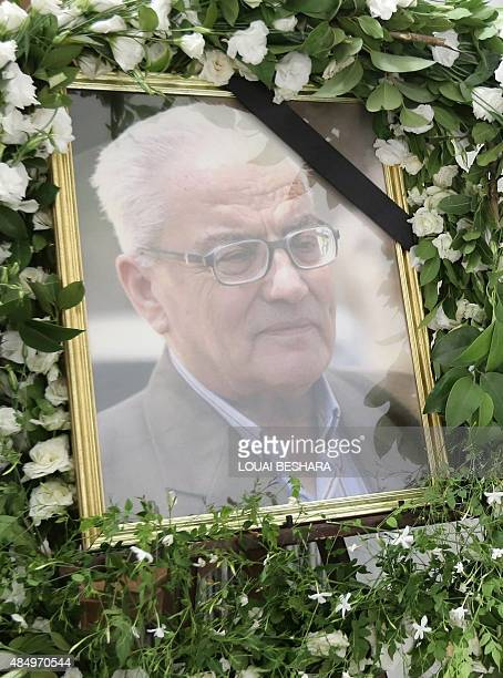 A portrait of Khaled alAssaad the late 82year old retired chief archaeologist of the ancient Syrian city of Palmyra is displayed during a ceremony in...