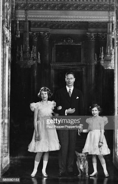 Portrait of King George VI with his daughters Princess Elizabeth and Princess Margaret and their pet corgi at Buckingham Palace London 1938