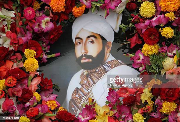 A portrait of King Habibullah Kalakani is seen during a funeral ceremony in Kabul Afghanistan on September 1 2016 Vice President Abdul Rashid...