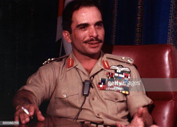 Portrait of King Hussein of Jordan dressed in a military uniform and with a cigarette in his right hand 1970