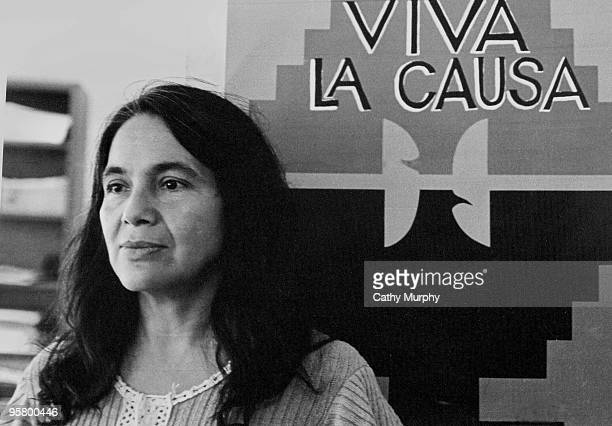 Portrait of labor activist Dolores Huerta cofounder of the United Farm Workers group with a union flag that reads 'Viva La Causa' ca1970s