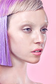 Portrait of lady with fashionable purple hair cut