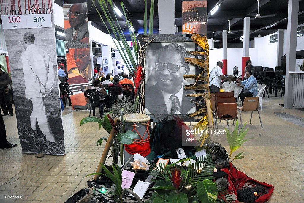 A portrait of late French poet and politician Aime Cesaire (C) is displayed on January 21, 2013 at the Martinican Progressive Party (PPM) headquarters in Fort-de-France, on the French Caribbean island of Martinique, marking the 100th anniversary of Cesaire's birth. Cesaire (June 25, 1913 – 17 April 2008) was former mayor of Fort-de-France and had funded the PPM party in 1958. As a pioneer of the black pride movement, Cesaire was a cult figure on his native island of Martinique and in the French-speaking world. With fellow writers such as Leopold Sedar Senghor of Senegal, 'Papa Cesaire' invented the term 'negritude,' which he defined as an 'affirmation that one is black and proud of it', decades before the emergence of Steve Biko or Martin Luther King.