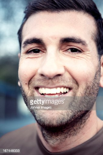 Portrait of laughing mid adult man : Stock Photo