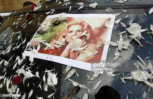 Portrait of Lebanese singer Sabah whose real name was Jeanette Gergis AlFeghali is seen on the funeral vehicle during the funeral ceremony held at...