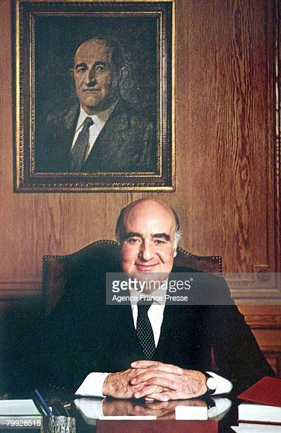 Portrait of Lebaneseborn Brazilian banker and financier Edmond Safra as he sits behind his desk 1990s The painting on the wall shows his father Jacob...