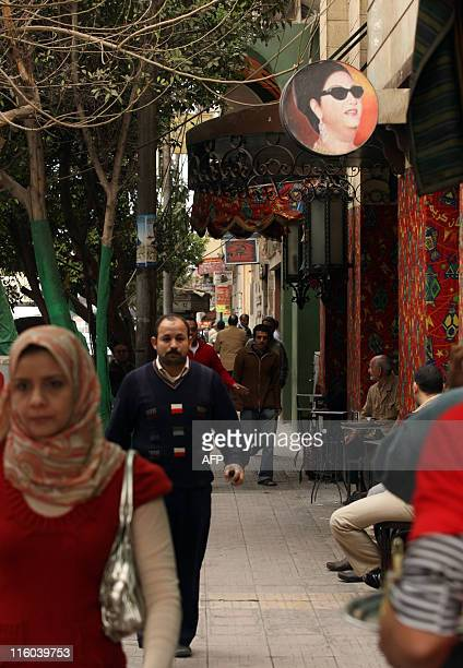A portrait of legendary Egyptian diva Umm Kulthum hangs outside a cafe in Cairo on February 3 2010 Thirtyfive years after her death the star's famous...