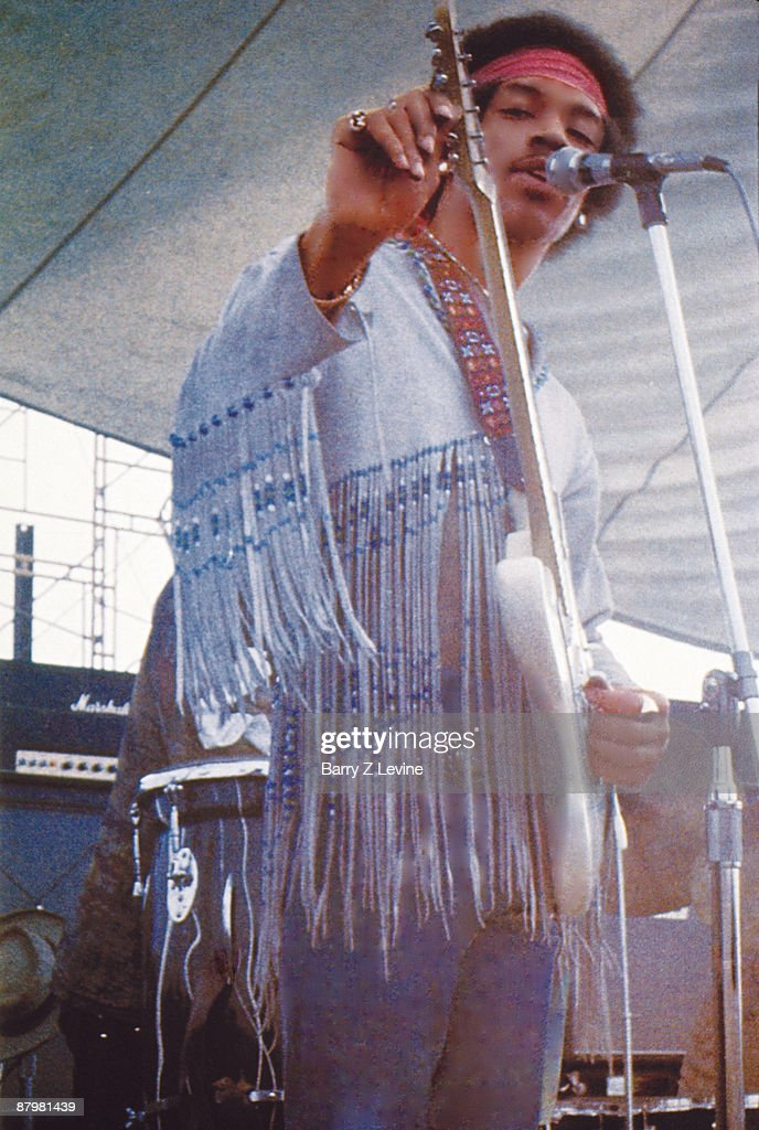 Portrait of legendary guitarist Jimi Hendrix who with his band the Gypsy Sun And Rainbows performed the last set onstage at the Woodstock Music and...