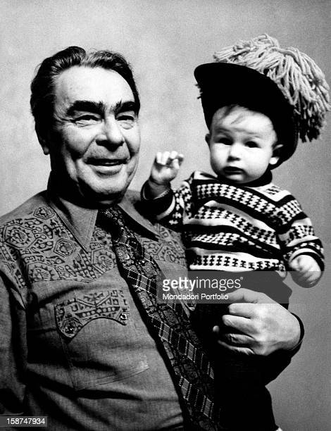 Portrait of Leonid Ilyich Brezhnev General Secretary of the Central Committee of the Communist Party of the Soviet Union holding in his arms his...