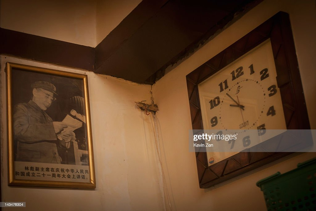 A portrait of Lin Biao, former army leader of China, is hung on the wall of a restroom at Shuangxing Tang Bathhouse on December 8, 2011 in Beijing, China. The Shuangxing Tang Bathhouse is the last remaining public bathhouse in Beijing and faces demolition as the area undergoes development. Opened on 1916, the bathhouse provides its patrons with a culture that is dying out, offering traditional treatments and massages it stands as a relic of the old Beijing, but with ever-decreasing water resources its future remains uncertain.