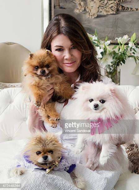 A portrait of Lisa Vanderpump with her dogs Dadio Giggy and Pink Dog during the VanderpumpPets' photo shoot on April 21 2015 in Los Angeles California
